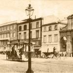 Piazza Cavour, si intravede il camino della fabbrica.